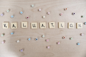 Scrabble tiles spelling out valuation