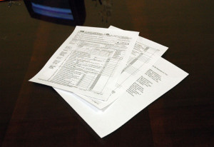 Tax forms prepared in a stack