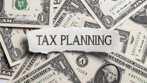 The word tax planning written atop a pile of saved money