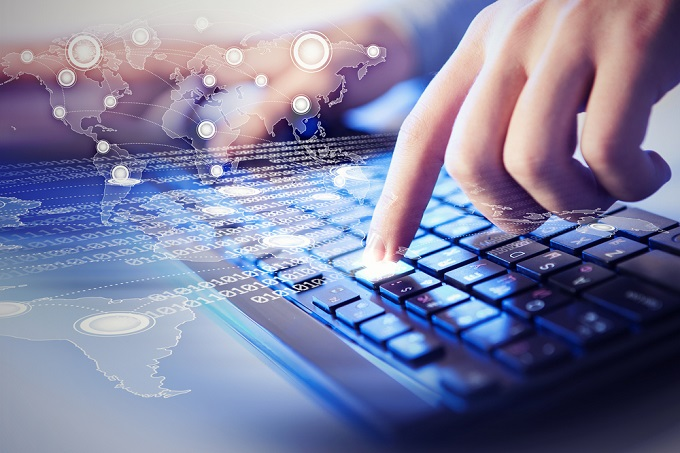 finger tapping a button to activate accounting software internationally.