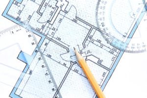 Engineers Blue Prints for construction project with a clear measuring tools and pencil