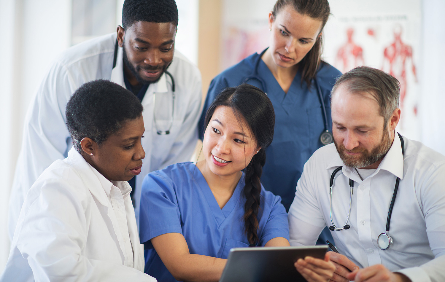 Nurse explaining medical results to doctos and medical professionals