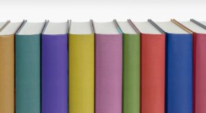 The Bindings of Colorful books of different sizes on a white background