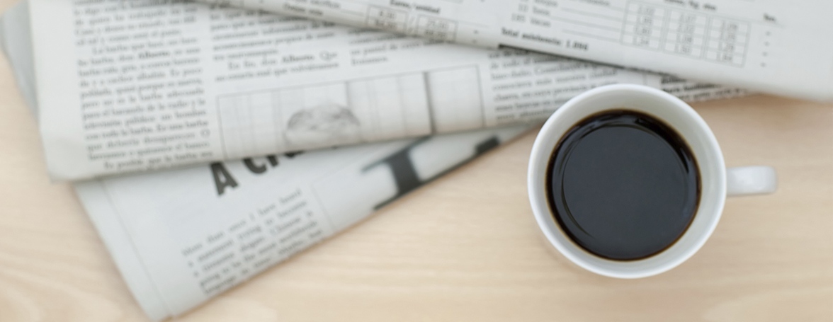 Flatlay of White Coffee Cup And Newspaper On Desk